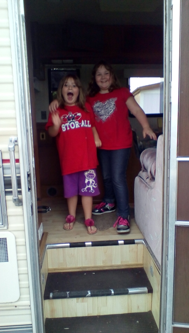 Both girls yelling in RV doorway
